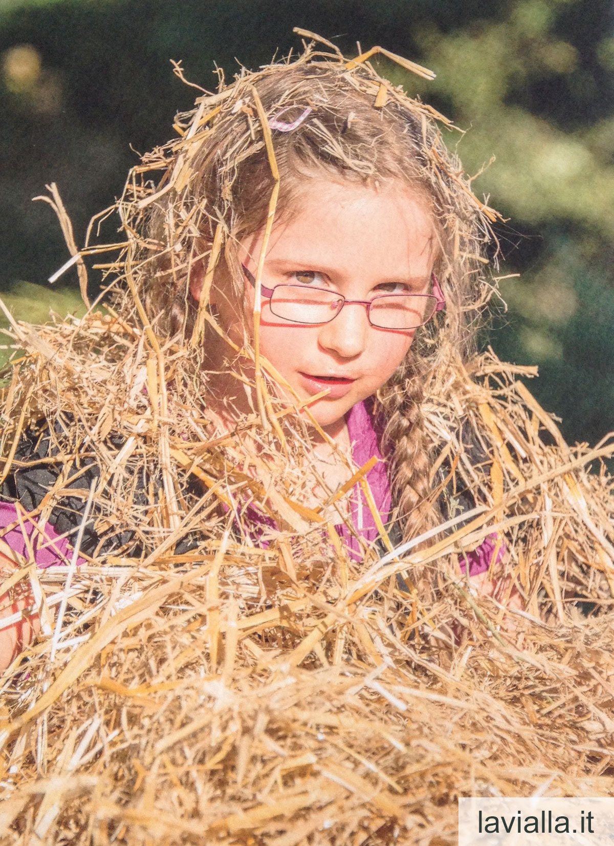 My daughter, Leandra, playing in a huge straw pile at LaVialla
